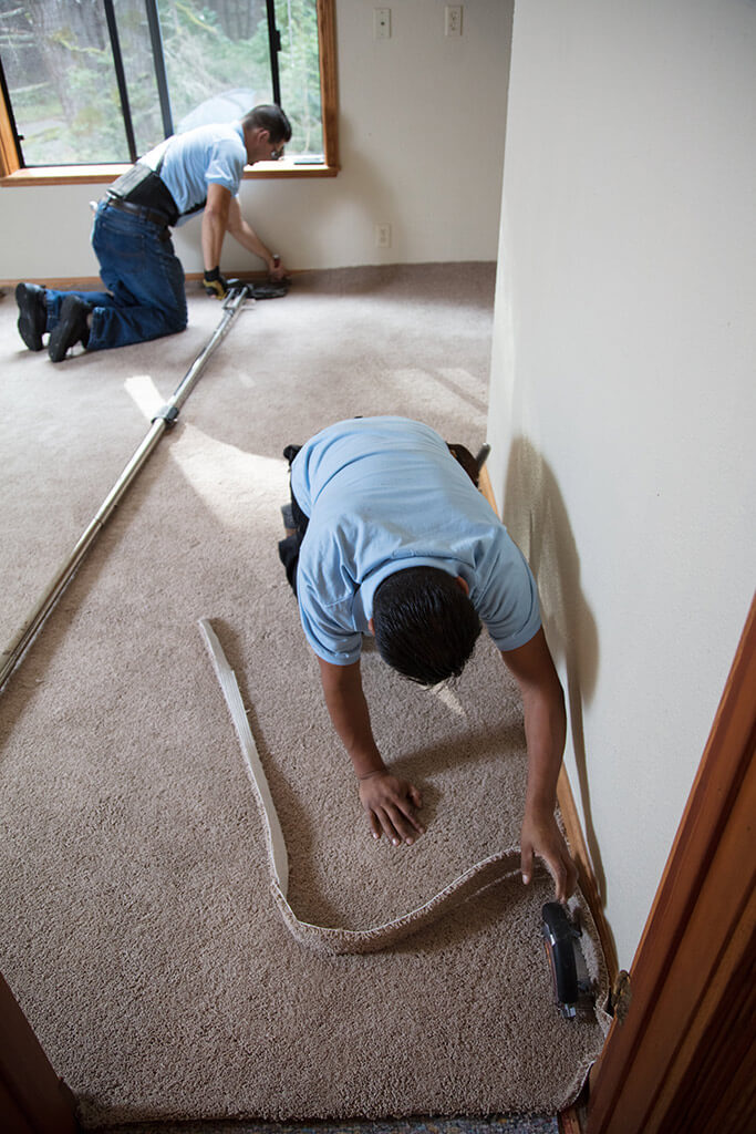 Restretching a carpet
